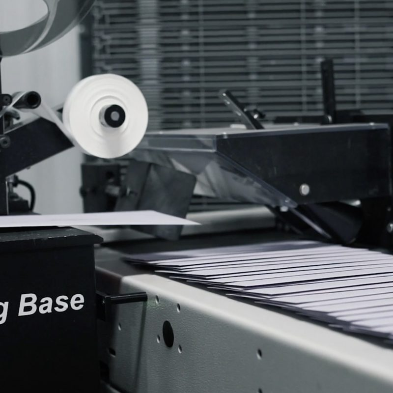 Our Inline Stamping Base, with letters flowing on its conveyor belt.