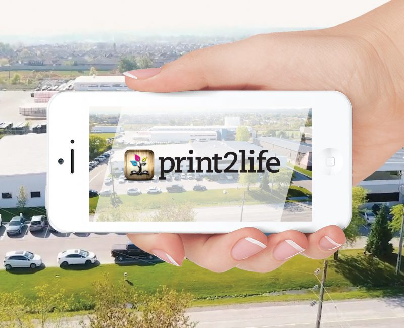 Print2Life Logo on an iPhone, being held horizontally